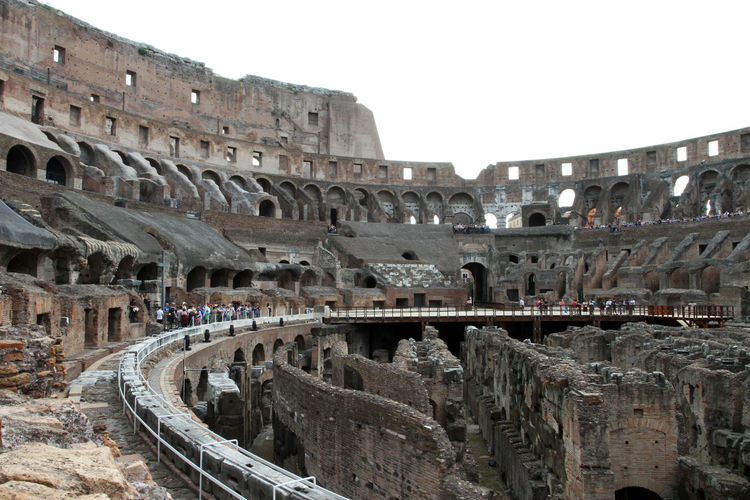 Amphitheater Ancient Ancient Civilization Arch Archaeology Arched Architecture Arts Culture And Entertainment Built Structure City Colosseum Day History Incidental People Nature Old Ruin Ruined Sky The Past Tourism Travel Travel Destinations