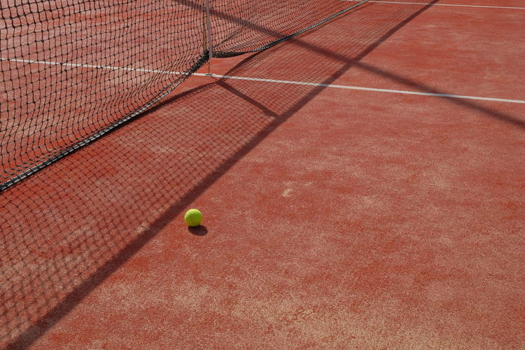 Backgrounds Ball Close-up Court Day No People Outdoors Racket Sport Red Shadow Sport Tennis Tennis Ball Tennis Net Textured  Paint The Town Yellow