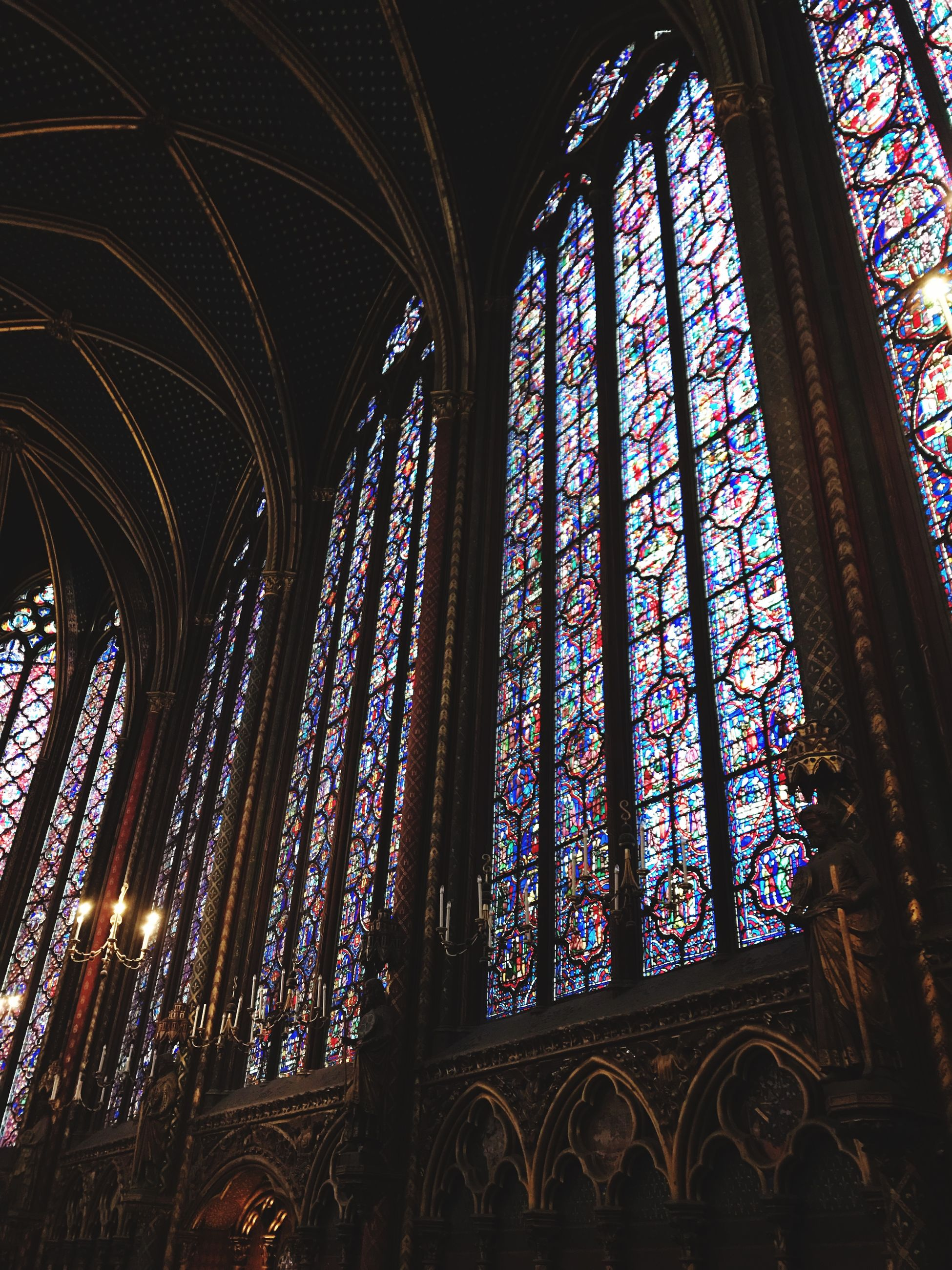 religion, place of worship, spirituality, stained glass, architecture, indoors, rose window, window, built structure, low angle view, no people, cross, day, multi colored
