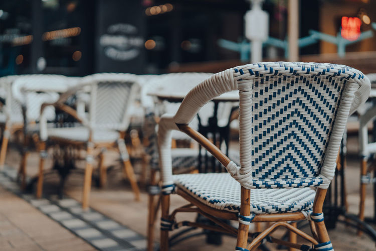 Outdoor chairs and tables of a restaurant, selective shallow focus.