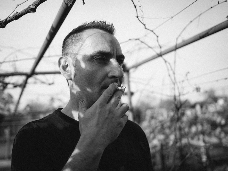 Blackandwhite Lifestyles One Person Outdoors Portrait Real People Smoking - Activity The Portraitist - 2017 EyeEm Awards