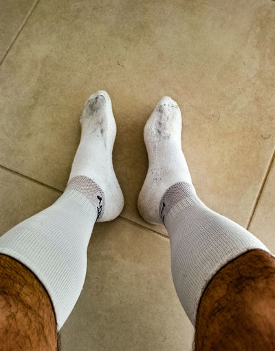 After the soccer game Pair Of Socks Soccer Soccer Player Soccer Socks Resting Resting Time Resting After Game Resting After Soccer Before Shower Dirty Socks White Socks Low Section Men Standing Human Leg Shoe High Angle View Close-up Human Foot Feet Sole Of Foot Sock Pair Human Feet Footwear