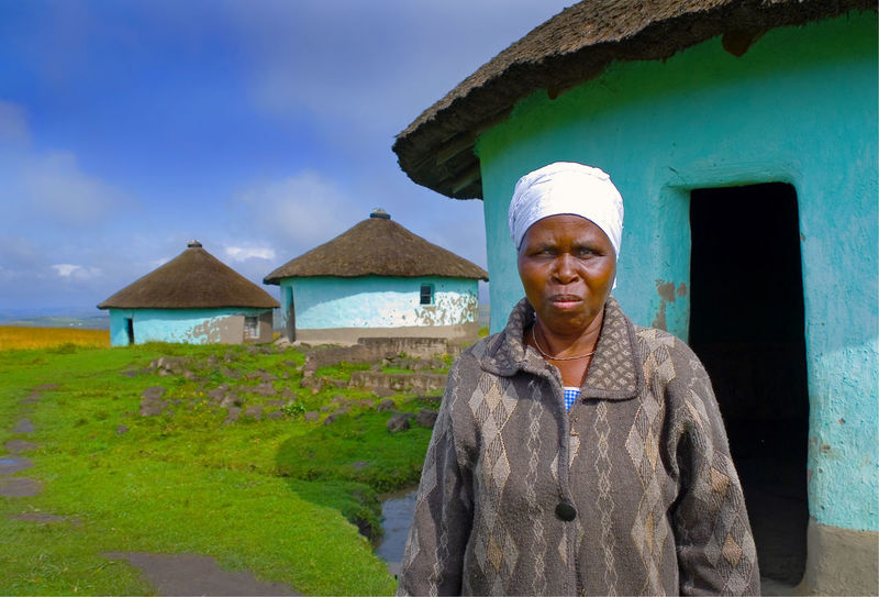Blind indigenous woman in Coffee Bay, South Africa South Africa Adult Architecture Blinds Building Building Exterior Built Structure Coffee - Drink Day Front View Lifestyles Looking At Camera One Person Outdoors Portrait Real People Sky Standing Waist Up Women