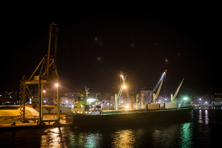 Architecture Business Finance And Industry Commercial Dock Harbor Illuminated Low Angle View Nature Nautical Vessel Night No People Outdoors River Shipping  Sky Star - Space Transportation Water