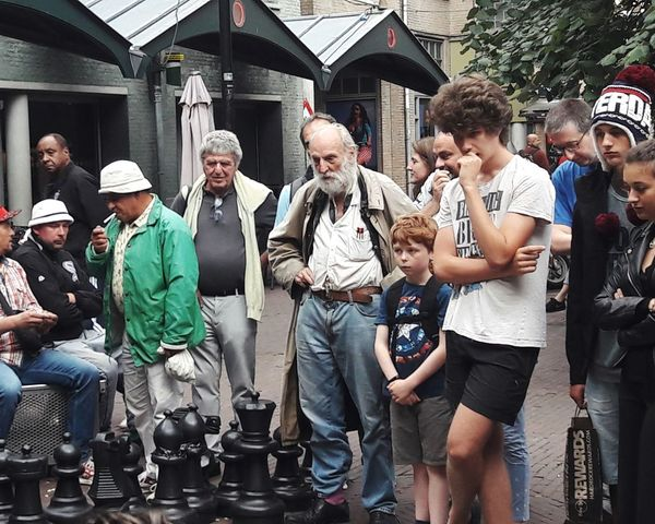 people who are focused on the game People Watching Chessgame Chess Time Concentration Streetphotography Street Chess Togetherness Standing Building Exterior Casual Clothing