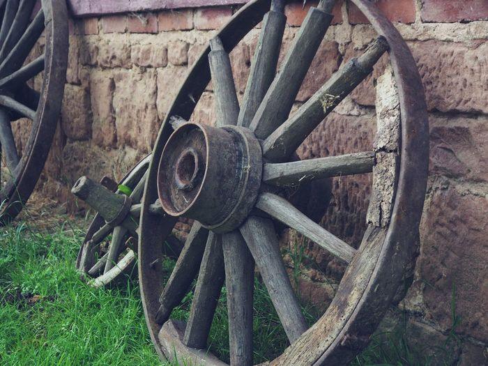 Old rusty wheel on field