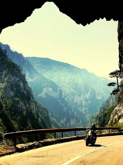 Mountain Nature Scenics Landscape Outdoors Motorbike Ride A Bike  Free Vacations Be. Ready. EyeEmNewHere One Person Hit The Road Rock Formation Tunnel Road Travel Destinations Feeling Free Tree Summer Driving Byker