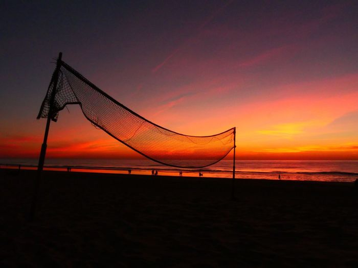 mood on the beach Sunset Sky Orange Color Beauty In Nature Scenics - Nature Beach Water Sea Land Silhouette Sport Net - Sports Equipment Nature No People Tranquility Idyllic Cloud - Sky Horizon Outdoors