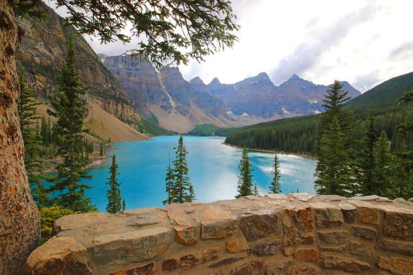 Tranquility Water Sky Beauty In Nature Mountain Nature Majestic Cloud Outdoors Calm Water Tree Tranquil Scene Tranquility Scenics Sky Beauty In Nature Mountain Nature Majestic Cloud Plant Growth Outdoors Day morraine lake