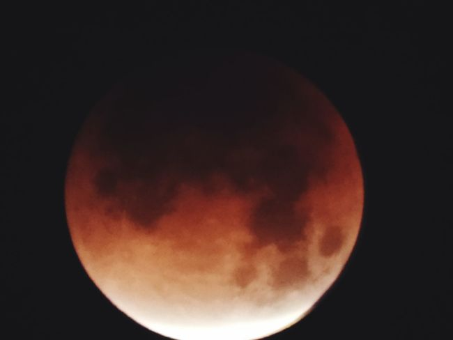 Super blue blood moon at about 95% eclipse Eclipse 2018 Bloodmoon Moon Night Astronomy Moon Surface Planetary Moon Beauty In Nature Nature No People Low Angle View Clear Sky Outdoors Space Close-up