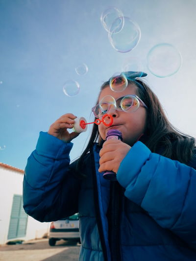 Woman standing at bubbles