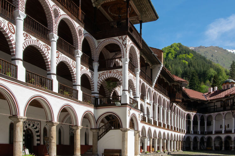 Rila monastery, Bulgaria - A Part of the orthodox monastery with arch style construction Ancient Arcade Arch Architectural Architecture Basilica Building Bulgaria Cathedral Catholic Christ Christianity Church Culture Europe Exterior Façade Faith Famous God Heritage Historic Historical History Jesus Monastery Monument Old Ornament Orthodox Palace Religion Religious  Rila Monastery Sacred Saint Spirituality St Ivan Rilski Structure Style Temple Tourism Traditional Travel Unesco View Wall