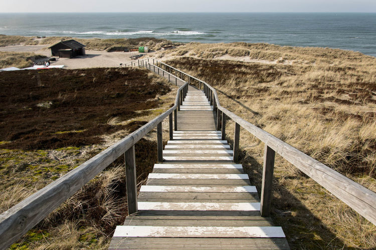 Sylt, Germany Ocean Stairs Followthepath Land Sea Horizon Water Horizon Over Water Nature Direction Day Railing The Way Forward No People Staircase Sky Beach Outdoors Steps And Staircases Wood - Material