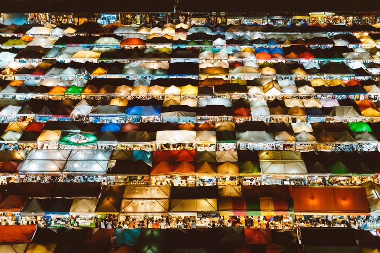 Low angle view of colourful illuminated market stalls