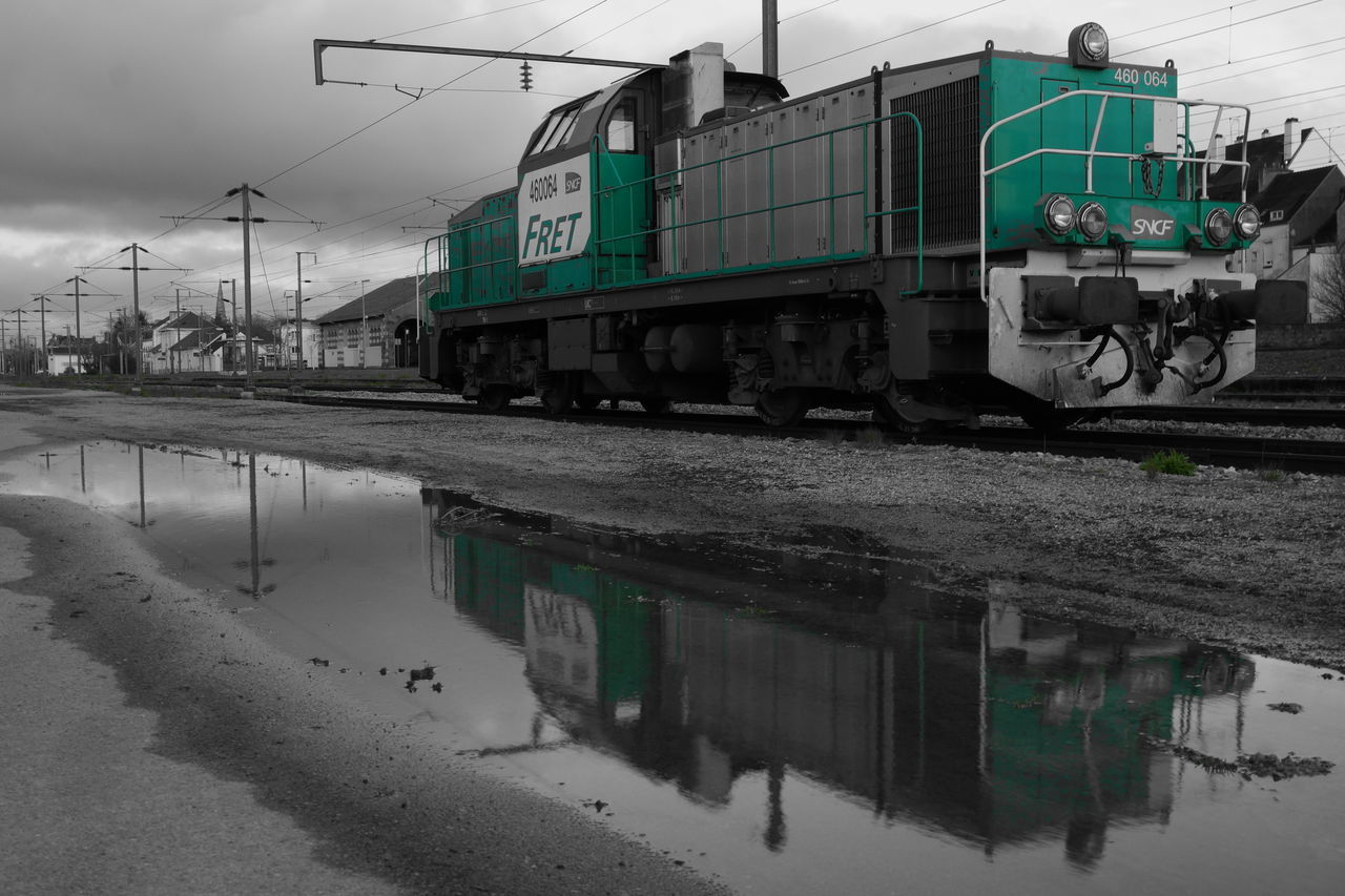 transportation, train - vehicle, mode of transport, rail transportation, railroad track, reflection, water, outdoors, sky, day, no people
