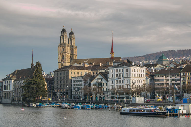 Zurich city center with famous Grossmunster and river Limmat, Switzerland Christmas Time Cloud Grossmünster Zürich Limmat Winter Zürich Architecture Boats Building Building Exterior Built Structure Card City Close-up Europe Grossmünster Nautical Vessel Place Of Worship River Swiss Switzerland Town Transportation Travel Destinations Water