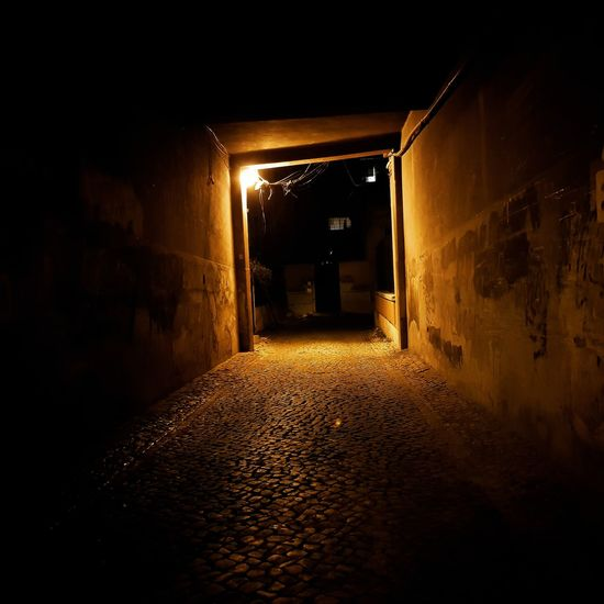 The dead end! Illuminated Cellar Basement Tunnel Light At The End Of The Tunnel Arched Archway Alley