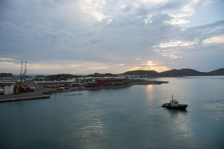 NOUMEA,NEW CALEDONIA-NOVEMBER 25,2016: Waterfront, and boat in the Pacific Ocean at sunset in Noumea, New Caledonia. Noumea Shipping Containers Architecture Beauty In Nature Boat Cloud - Sky Commercial Dock Landscape Mode Of Transport Mountain Nature Nautical Vessel New Caledonia Outdoors Pacific Ocean Pilot Boat Scenics Sea Sky Sunset Tranquil Scene Tranquility Transportation Water Waterfront