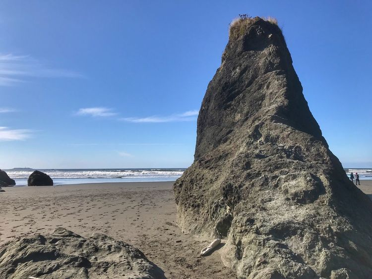 Large vertical stone at Ruby Beach in Olympic national Park Sea Rock - Object Nature Beach Scenics Beauty In Nature Tranquil Scene Outdoors No People Water Sky Sand Blue Sunlight Day Tranquility Rock Formation Horizon Over Water
