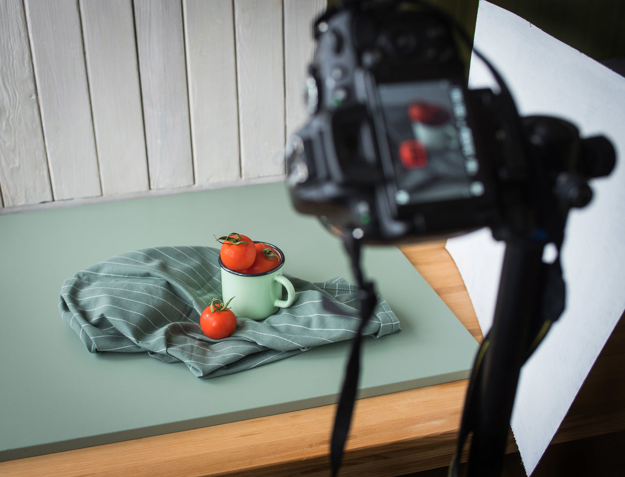 High angle view of tomatoes and mug on table