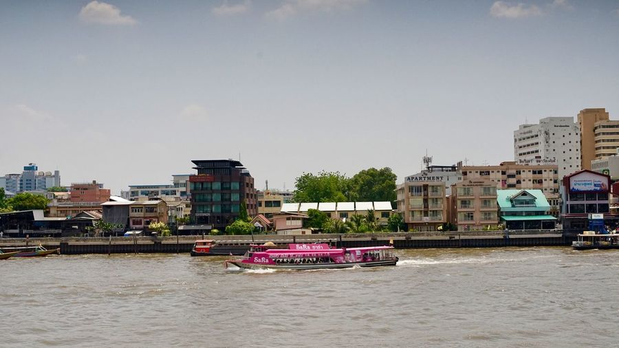 Pink boat in Chao Phaya river Architecture Building Exterior Built Structure City Sky Mode Of Transportation Nature No People Building Day Land Vehicle Transportation Plant Outdoors Water Nautical Vessel Motor Vehicle Tree Clear Sky