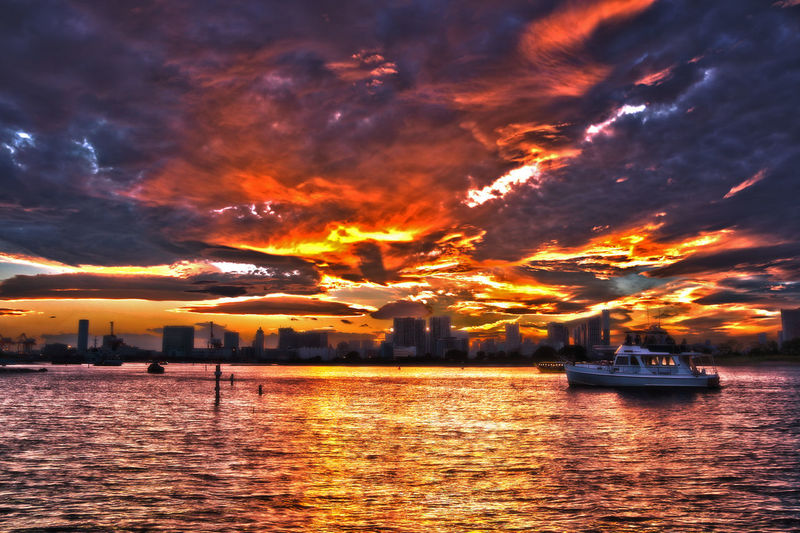 Architecture Atmosphere Atmospheric Mood Beauty In Nature Building Exterior City Cityscape Cloud Cloud - Sky Cloudy Dramatic Sky Nautical Vessel Orange Color Overcast Scenics Sea Sky Storm Cloud Sunset Tranquil Scene Tranquility Transportation Travel Destinations Water Waterfront