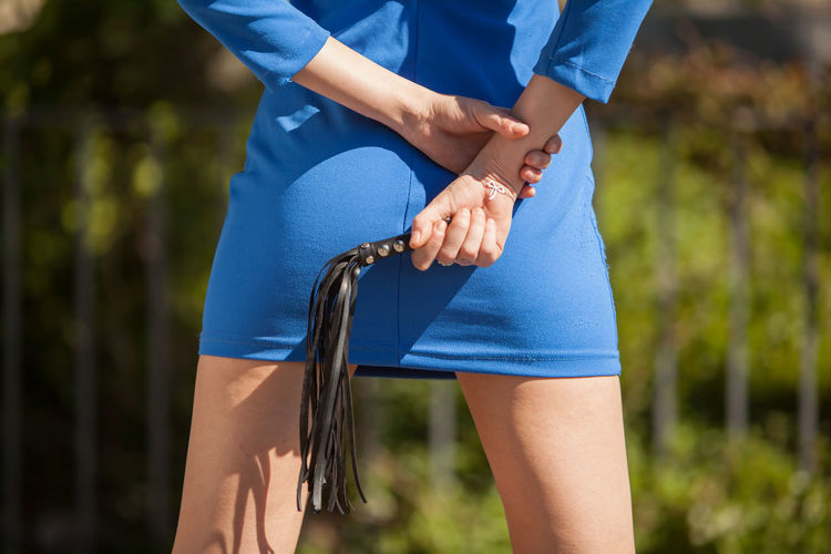 Girl with a blue skirt and a little whip Adult Adults Only Beauty Blue Close-up Exercising Healthy Lifestyle Human Body Part Human Hand Jogging Legs Lifestyles Midsection One Person One Woman Only Only Women Outdoors People Skinny Skirt Sport Sports Clothing Sports Training Whip Women
