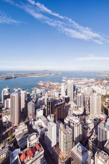 Aerial view of buildings against sky in city