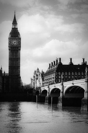 Big Ben and Westminster Bridge over the Thames. Big Ben Westminster Bridge London Famous Landmarks Uk Westminster River Thames Black And White Photography Monochrome Photography Black And White Monochrome Incidental People Sightseeing Tourism Travel Gothic Architecture Unesco