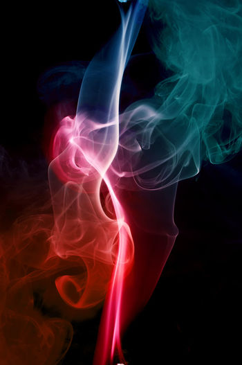 colored smoke on black background Changing Form Natural Pattern Blurred Motion Complexity Luminosity Moving Up Curve Abstract Incense Burning Close-up No People Black Background Swirl Smoke - Physical Structure Illuminated Pattern Nature Textured  Studio Shot Motion Indoors  Flowing