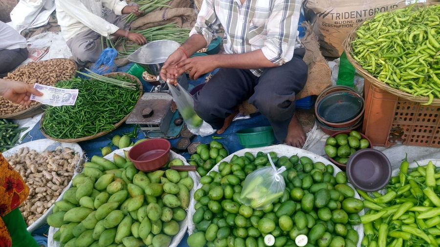 Vendor selling vegetable at market