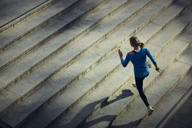 High angle view of man running on staircase in city