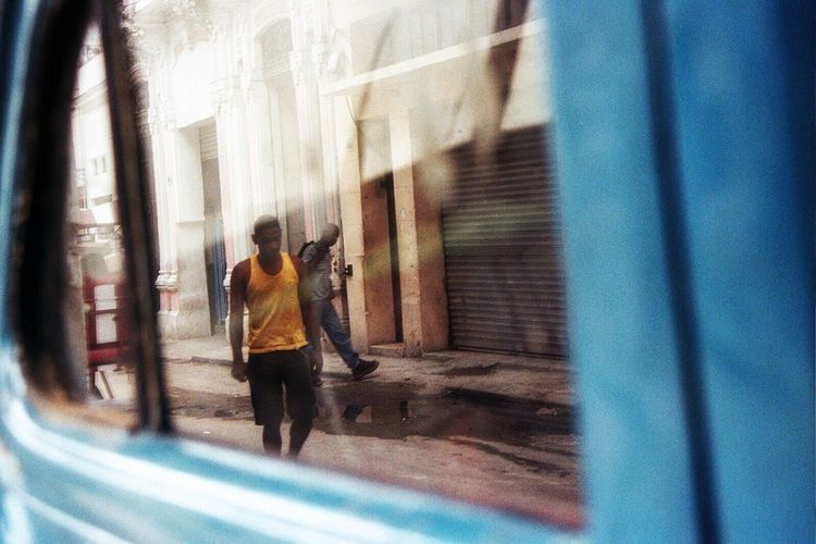 Rear view of man against window