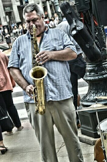 Leisure Activity Lifestyles Casual Clothing Street Men Holding Person Focus On Foreground Young Adult Outdoors The Way Forward Brass Instruments Brass Saxophonist Saxophone Sax Music Musician City City Life Indulgence Close-up Part Of Craftsperson