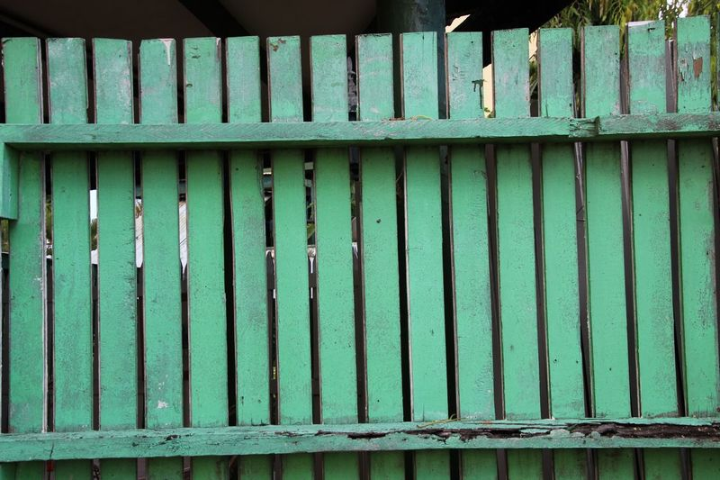 A beautiful old fence. Architecture Backgrounds Bluish Green Close-up Cracked Day Full Frame In A Row Natural Patina No People Old Fence Old One Pattern Repetition Vintage Wood Fence