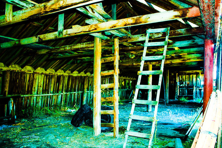 Wooden ladders in old room