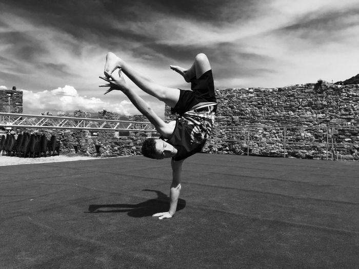 Man breakdancing on stage against sky