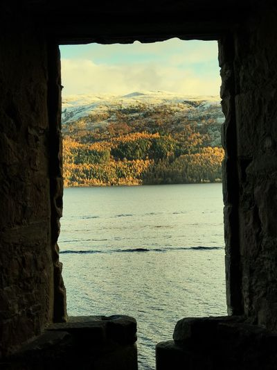 Urquhart Castle Water Nature Scenics Beauty In Nature Tranquil Scene Sky Day Window Tranquility Built Structure Sea Tree Architecture Mountain