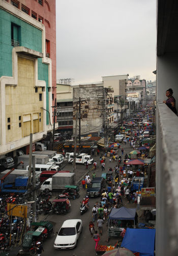 Manila Philippines Motor Vehicle Mode Of Transportation City Car Transportation Building Exterior Land Vehicle Architecture Street Built Structure Road Incidental People Traffic Sky City Life High Angle View Day Building Nature City Street Outdoors Busy Traffic Jam