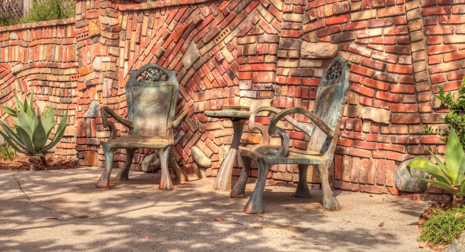 Laguna Beach, California, April 22, 2017: Bronze chairs at Browns Park in Laguna Beach, California. Editorial use only. Architecture Bricks Bronze Brown's Park Built Structure Chair Chairs Day Laguna Beach, CA No People Orange County Outdoors Park Statue Table