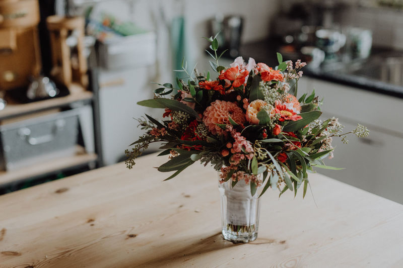 Beautiful wedding bouquet standing on a kitchen table Light Modern Natural Natural Light Wedding Wedding Photography Bouquet Close-up Colorful Flora Florist Flower Flower Head Fragility Freshness Home Interior Indoors  Interior Kitchen Nature No People Table Vase Wedding Dress