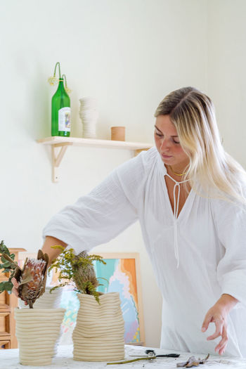 Portrait of the female florist working at her home studio