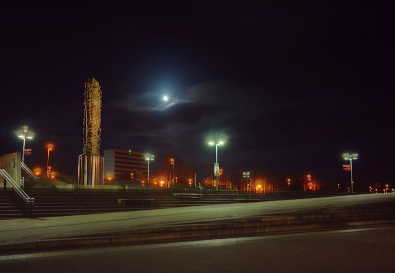 illuminated, night, street light, architecture, built structure, building exterior, sky, long exposure, city, road, outdoors, no people, modern, cityscape, high street