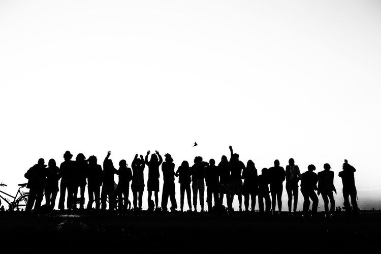 Silhouettes of people in row