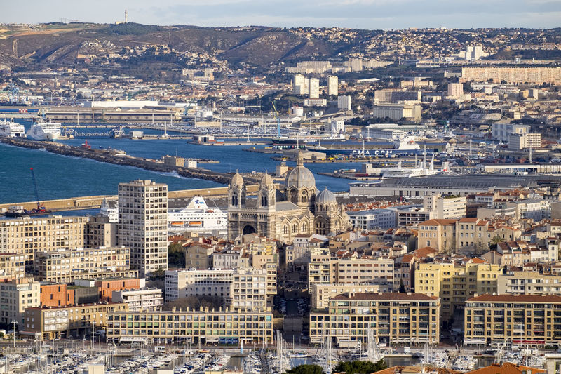 Aerial view of Marseille, France, from Notre-Dame de la Garde France France Marseille Mediterranean  Architecture Building Exterior Built Structure City Cityscape Crowded Day Europe High Angle View Outdoors People Travel Destinations Water