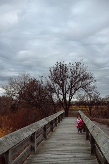 Photo essay - A day in the life. Platte River Grand Island, Nebraska November 6, 2016 A Day In The Life America Camera Work Cloud - Sky Eye Em Nature Lover Eye For Photography Footbridge MidWest Nebraska On The Road One Person Outdoors Photo Diary Photo Essay Road Trip Sky Storytelling The Way Forward Travel Photography Tree Visual Journal