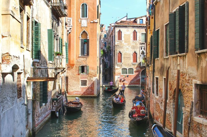 Romantic Architecture Building Exterior Built Structure Canal Canals And Waterways City Day Gondola Gondola - Traditional Boat Gondolier Italy Marry Men Mode Of Transport Nautical Vessel One Person Outdoors People Real People Rowing Transportation Venice Water Wooden Post
