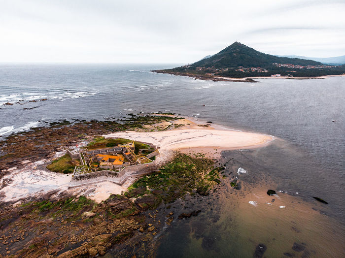 Aerial drone view over historic portuguese fortress in the atlantic ocean on the border of spain.