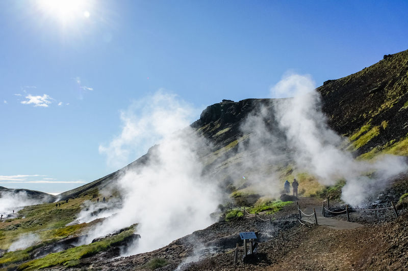 Valley of the river of Hveragerdi Iceland, small hot spring geyser on foreground. Beauty In Nature Day Geothermal Activity Geothermal Spa Hot Spring Icland Leisure Activity Low Angle View Men Motion Nature One Person Outdoors People Power In Nature Real People Scenics Sky Water