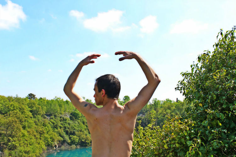 Men Nature One Person Outdoors Real People Rear View Shirtless Sky Standing Water